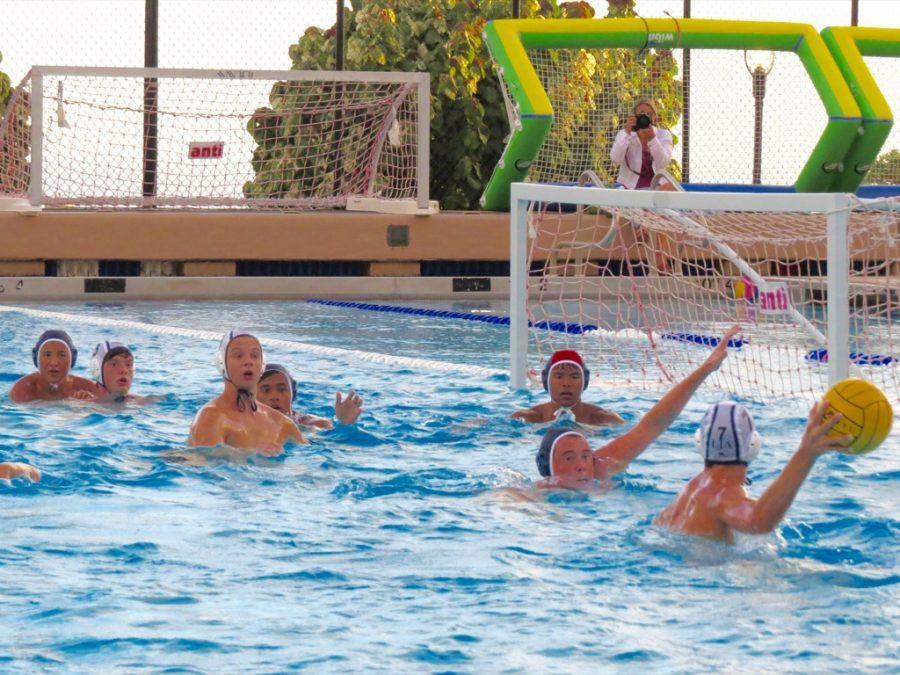 The+boys+Varsity+II+water+polo+team+holds+their+ground+against+Le+Jardin%27s+offense.+