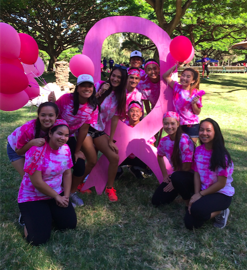 Student volunteers posed for group pictures after breaking down equipment at the Susan G. Komen race for a cure.
