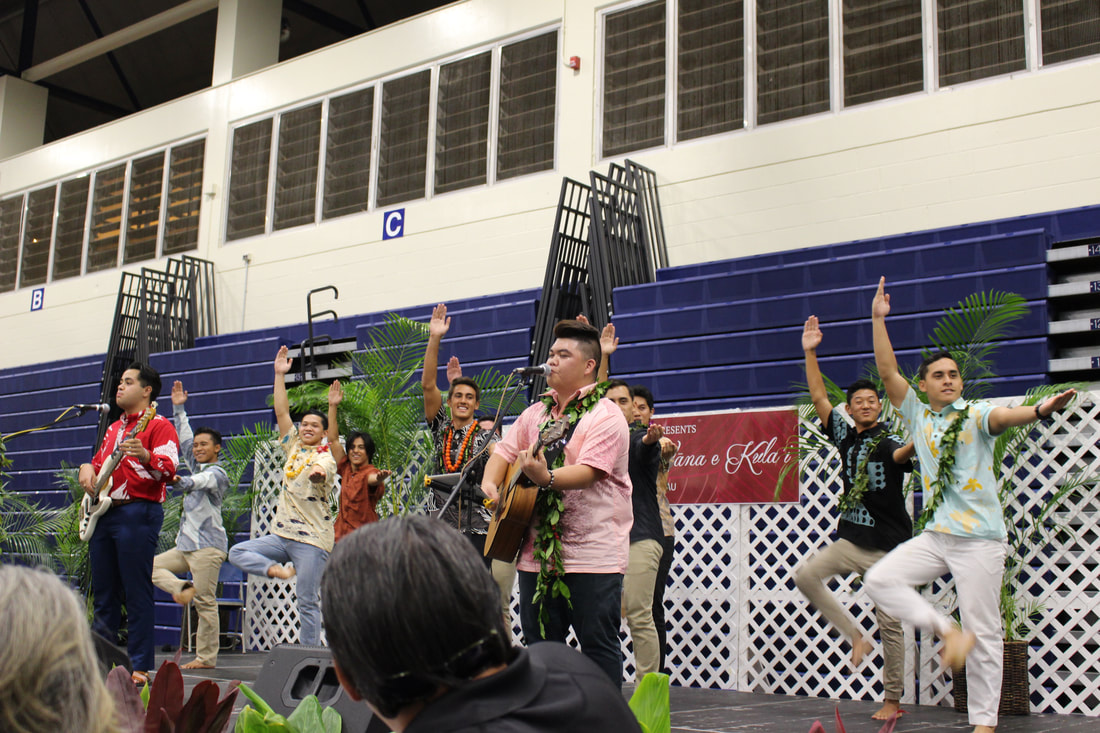 Class of 2018 students ʻElia Akaka and Kona Abergas were performing the song Nā Peʻa when members of the Hawaiian Ensemble jumped onstage to join them in dance.  Photo courtesy of Hamilton Keola.