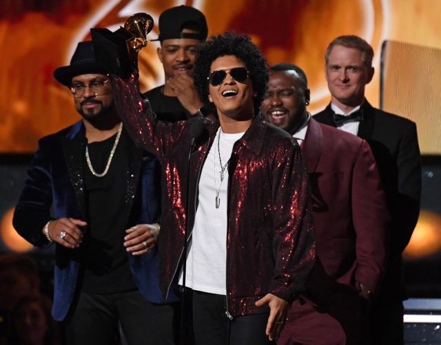 Bruno+Mars+receives+his+third+Grammy+for+Album+of+the+Year+during+the+60th+Annual+Grammy+Awards+show+on+January+28%2C+2018%2C+in+New+York.++%2F+AFP+PHOTO+%2F+Timothy+A.+CLARY++++++++