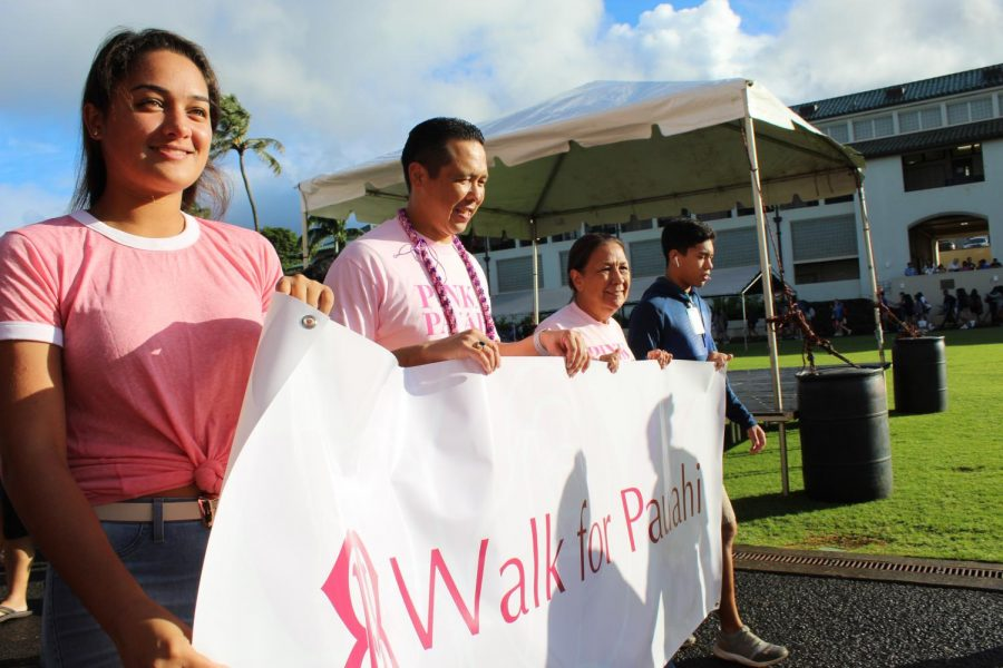 Poʻokula Dr. Taran Chun, leads the walk for Pauahi parade around Konia circle.