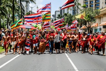 Thousands march down the streets of Waikiki, exhibiting Native Hawaiian pride and support.