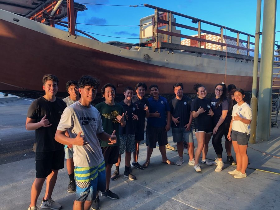 Paddling athletes and managers give back to the Polynesian Voyaging Society.