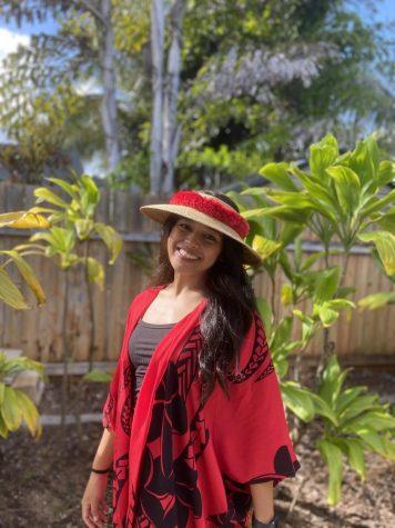 Tiare Cardejon posing with one of her kimonoʻs.